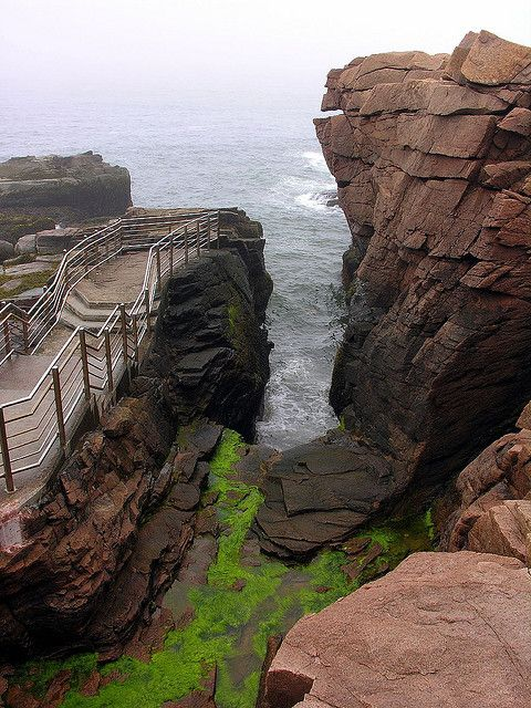 Thunder Hole - a place in Acadia National Park where the water has eroded and collapsed the granite to create an alcove.