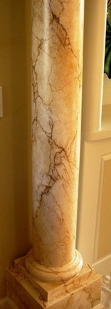 Marbled columns created with faux finishing techniques appear realistic thanks to the artist's talents.