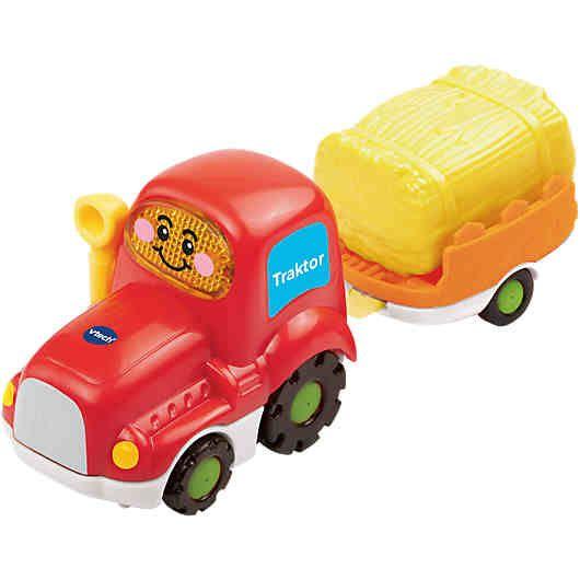 Los geht's, lass uns aufs Feld fahren - mit dem Tut Tut Baby Flitzer Traktor mit Anhänger von vtech Baby!<br /> <br /> Der robuste Traktor mit Anhänger begleitet Ihren kleinen Entdecker beim ersten Rollenspiel. Das Kind wird dazu animiert den Flitzer mit oder ohne Anhänger durch den Raum zu schieben. Dabei ertönen lustige Sätze, gesungene Lieder und Geräusche. Eine blinkende Taste lädt zum weiteren Erkunden des Fahrzeugs ein. Anstelle des abnehmbaren Strohballens kan...