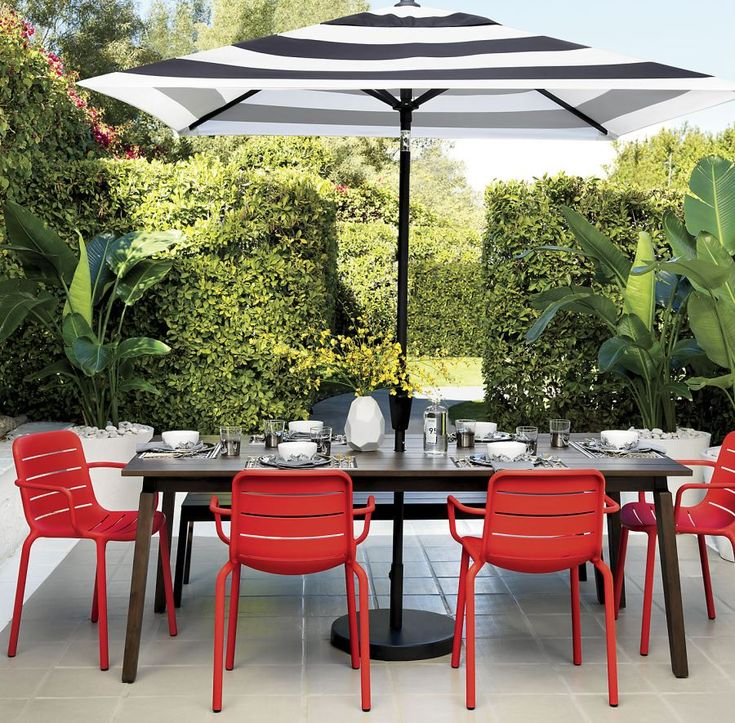 Striped Umbrella from CB2 - Bold Outdoor Accessories http://www.uk-rattanfurniture.com/product/charles-bentley-garden-pod-chair-shell-ball-globe-armchair-for-garden-patio-deck/