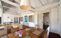 Opening out to the garden, the living and dining area is furnished in old teak wood as well.