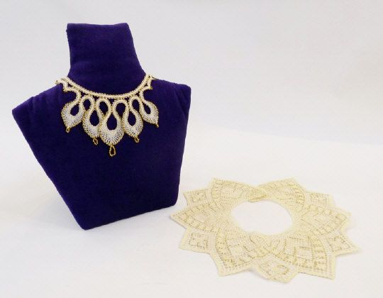 Lace napkins, lace pieces in plastic wallets and a lace and gold bead necklace.   Estimate £20.00 to £40.00 (Lot no: 308 in sale on 05/08/2014) The Cotswold Auction Company