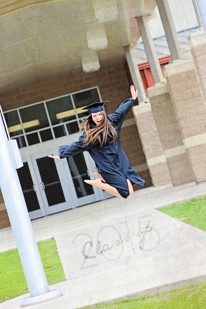 High school senior 2015 cap and gown picture Dion Latham photography fun pose senior pose