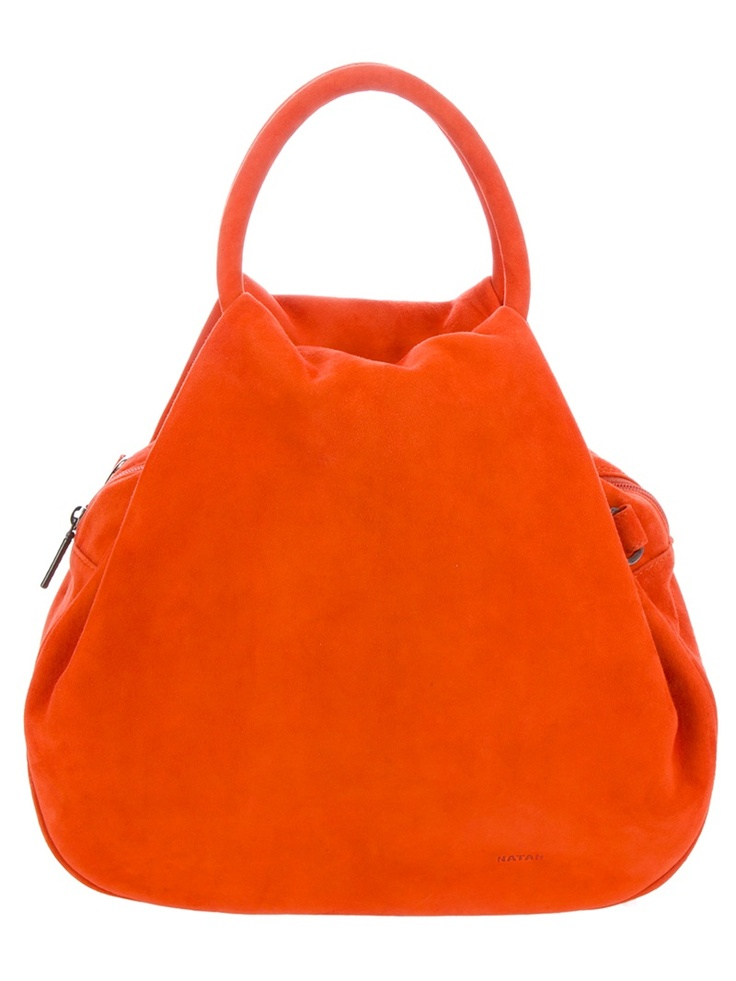 Incredible color and perfect for all occasions! Orange suede bag from Natan featuring two orange handles, a top zip closure and a cotton lining.