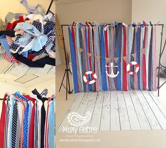 Augusta GA Newborn Portrait Photographer images of a nautical theme custom set with multiple colored ribbons, a posterboard anchor and lifesavers | Mary Beth
