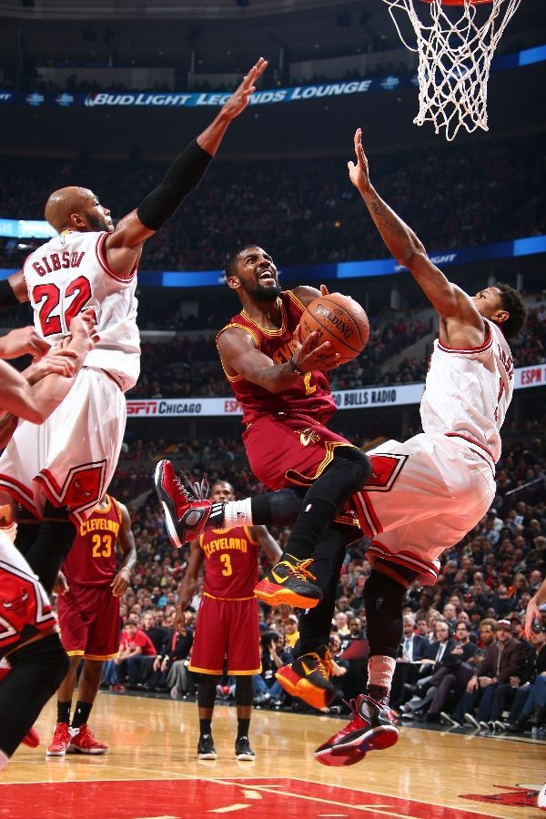 Kyrie Irving #2 of the Cleveland Cavaliers takes a shot against the Chicago Bulls during a game at the United Center on October 31, 2014