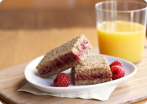 Whole Grain Raspberry Breakfast Bars: just made these, and they're delicious! My version just used strawberry jam and used pearled barley instead of wheat germ. Cut into 14 bars, 216 calories apiece. Chewy, crunchy, sweet, toasty...basically, everything I've ever wanted in a breakfast bar. A healthy and filling way to start the day.