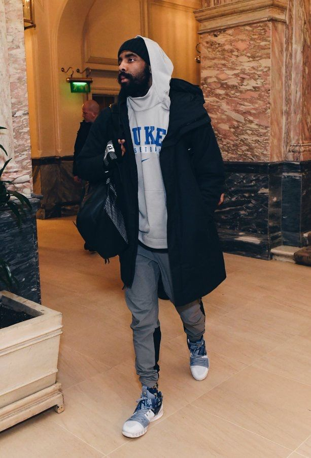 """d65dcbbb5c50  KyrieIrving wearing Kyrie S1 Hybrid """"Vivid Blue"""" shoes while heading to  London and a Duke hoodie."""