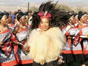 Princess Fikisiwe Dlamini of Swaziland dances with her entourage at the wedding in Nkandla. The bride wore traditional wedding regalia complete with a metal sword