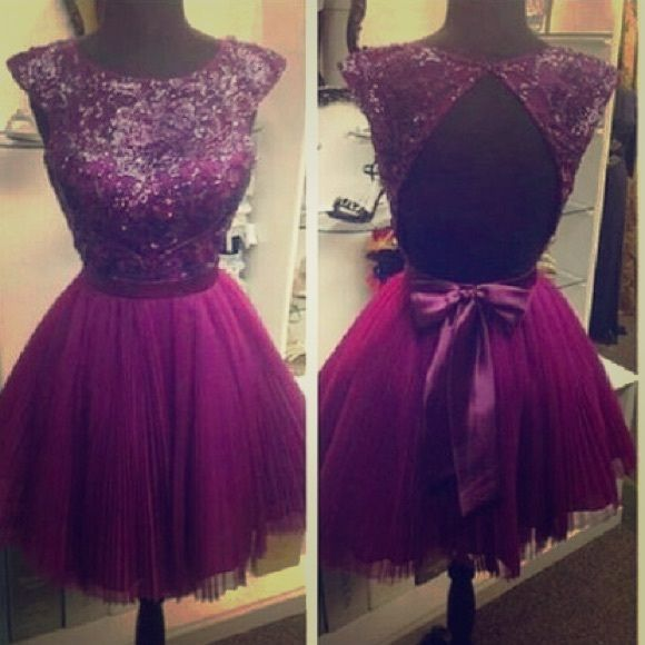 Dark purple short prom dress A dark purple dress with beading. Perfect for prom!! Dresses