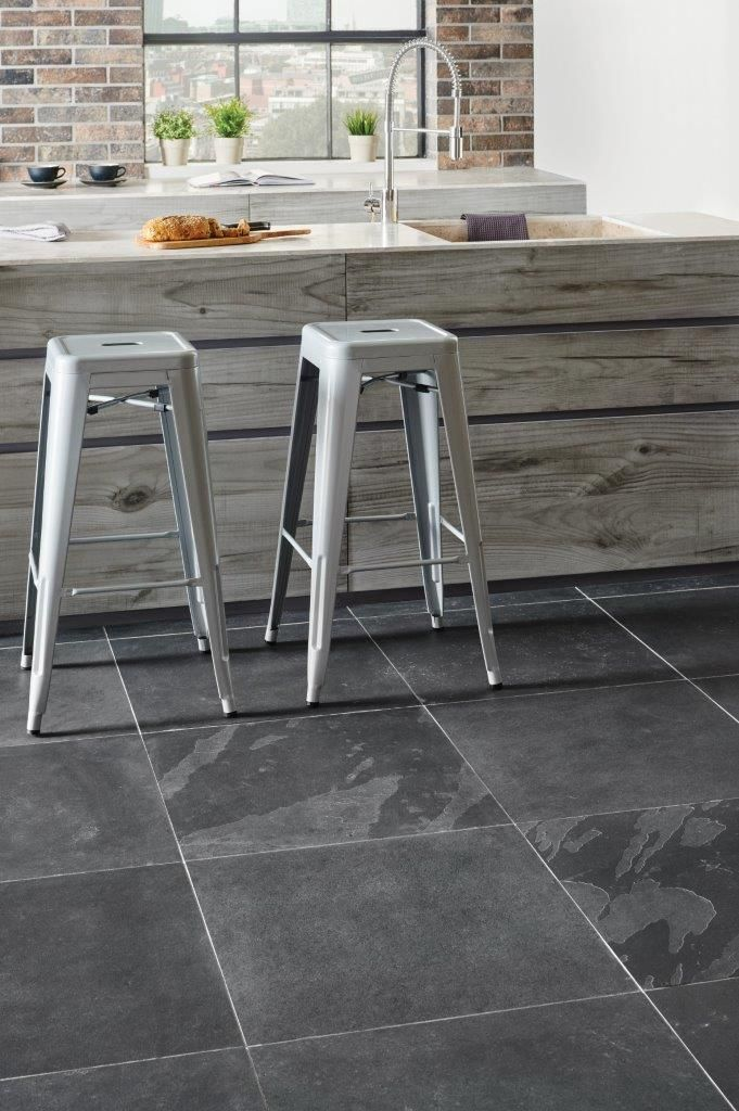 A classic - Graphite Black slate tiles in a larger size will fit into contemporary and traditional environments with ease. The chic dark colour hides a multitude of sins, so is perfect for busy kitchens where a hardwearing surface is required. Can also be used in bathrooms and hallways or throughout the home. Part of Original Style's Earthworks collection. originalstyle.com
