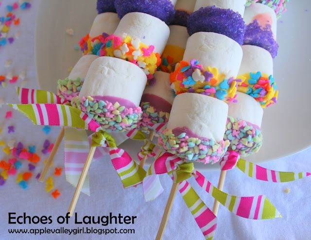 I'm envisioning marshmallows and other candies mixed on the sticks. That would provide color and variety AND eliminate the chocolate melting and dipping.