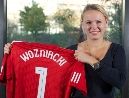 """Caroline Wozniack: The women's world No.1 tennis star kept a promise to thousands of her Twitter followers earlier this year by proudly wearing her signed Steven Gerrard Liverpool shirt on court. """"Got so many comments about the Liverpool jersey and to step out on court with it... So why not,"""" she tweeted afterwards."""