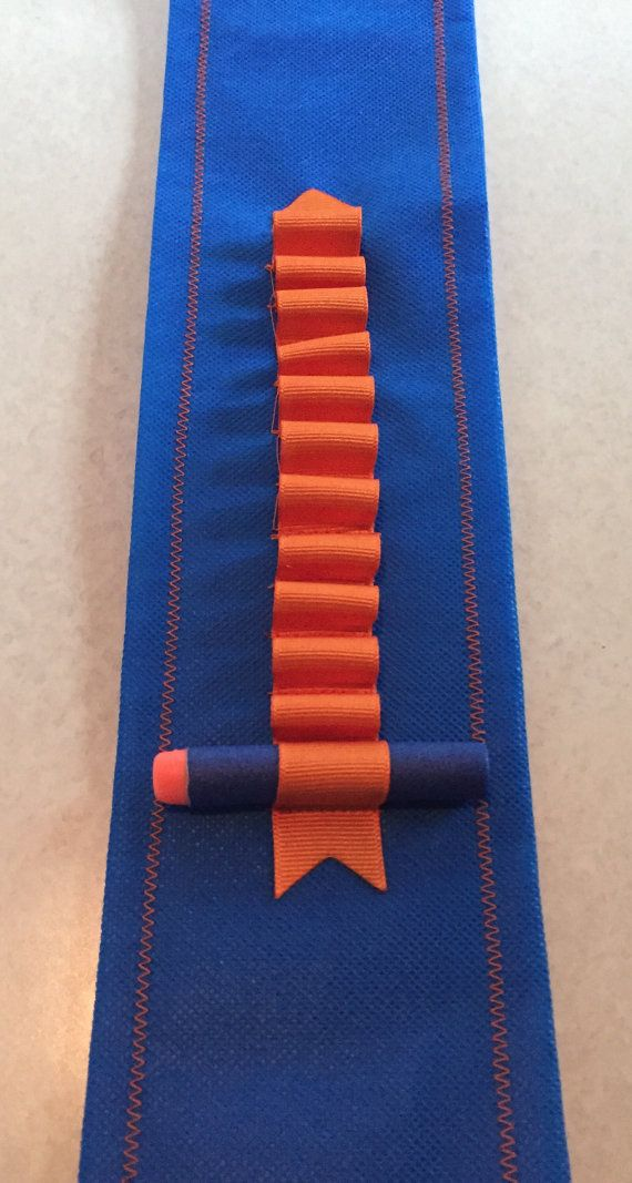 40 x 3 1/4 ages 2 to 6, 45 x 3 1/4 ages 7 to 12, nerf war bullet holster, sash shoulder belt with small pistol or bullet pocket on hip approx. 5w x 5 deep, and 7x7 on bigger kids. 12 individual ribbed ribbon bullet holders. Ships within 3 days of order. Red/black, green/black, black/yellow, blue/orange. Can do custom combination orders for parties. Message me. My grandsons love these perfect holders for hours of outdoor fun! Bullets pistol not included. Made of p...