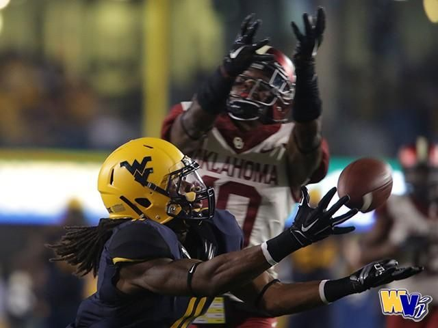 PHOTO GALLERY: WVU Falls to No. 4 Oklahoma on Electric Night in - WVU Football, WVU Basketball, News - Mountaineer Sports