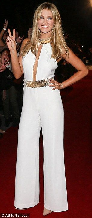 She nailed it! All eyes were on Deltas Goodrem at a The Voice Australia cocktail party in ...
