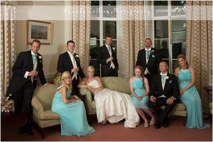 Bridesmaids in tiffany blue dresses and ushers with tiffany blue cravats