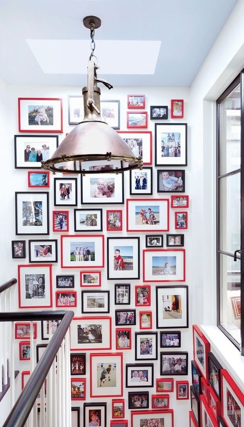 Cherry-red picture frames, balanced by more classic black ones, bring a sense of ordered chaos to an otherwise spare stairwell. ♨️  -----------------  #staircase #stairs #picture #frames #ideas #tips #diy