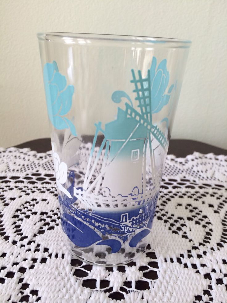 Vintage Windmill & Tulips Blue and White Drinking Glass - SALE by VintageLove50 on Etsy https://www.etsy.com/listing/202789119/vintage-windmill-tulips-blue-and-white