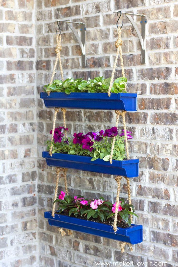 DIY Hanging Rain Gutter Planters | via Make It and Love It