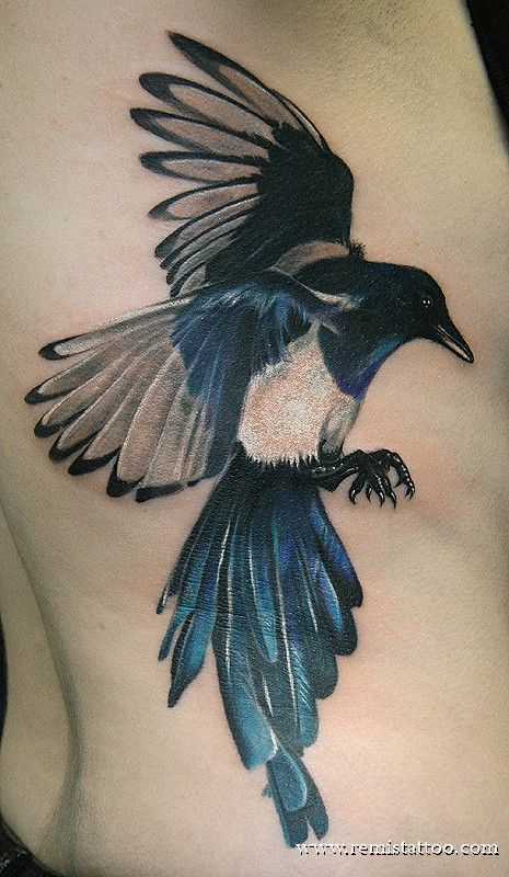 Flying magpie tattoo