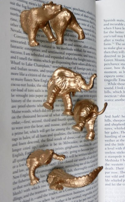Animal Magnets: buy plastic animals from dollar store, cut in half, spray paint gold, and glue magnet on bottom.