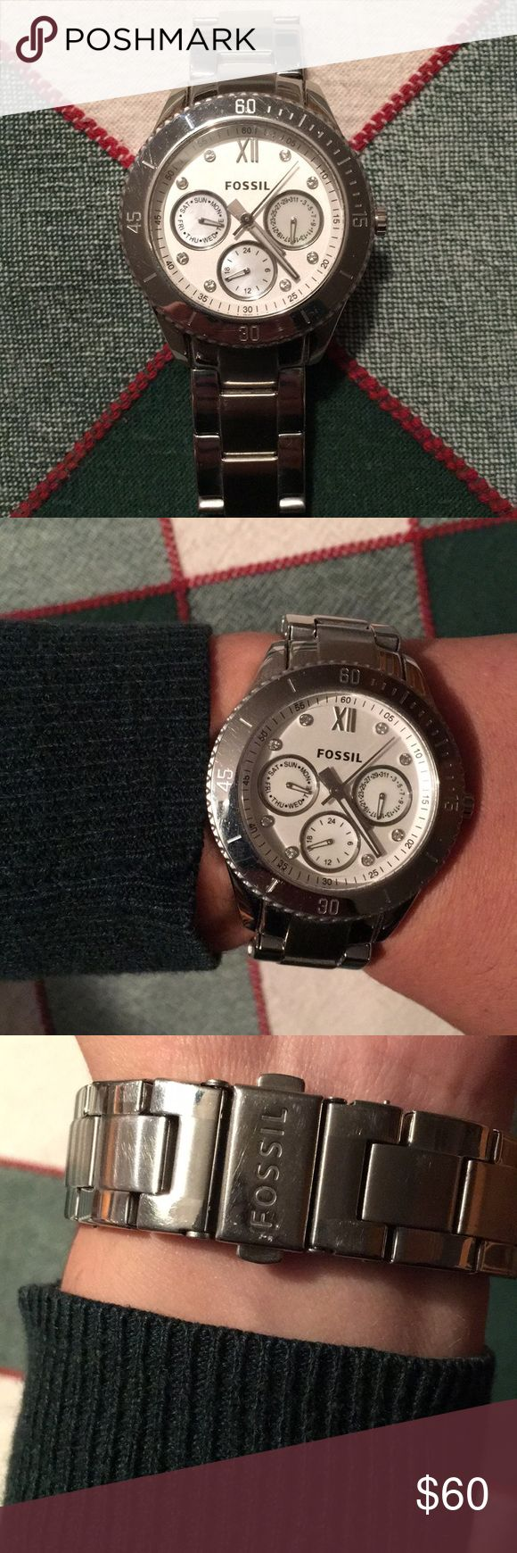 Silver Watch Women's large face watch. Barely used. As is, fits a 16 cm wrist circumference. 3 extra links and Fossil watch box included. In need of battery Fossil Accessories Watches
