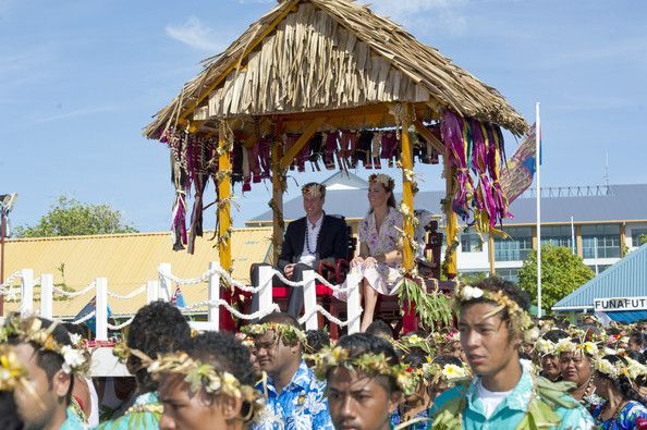 Prince William, Duke of Cambridge and Catherine, Duchess of Cambridge are carried as they bid farewell on September 19, 2012 in Tuvalu