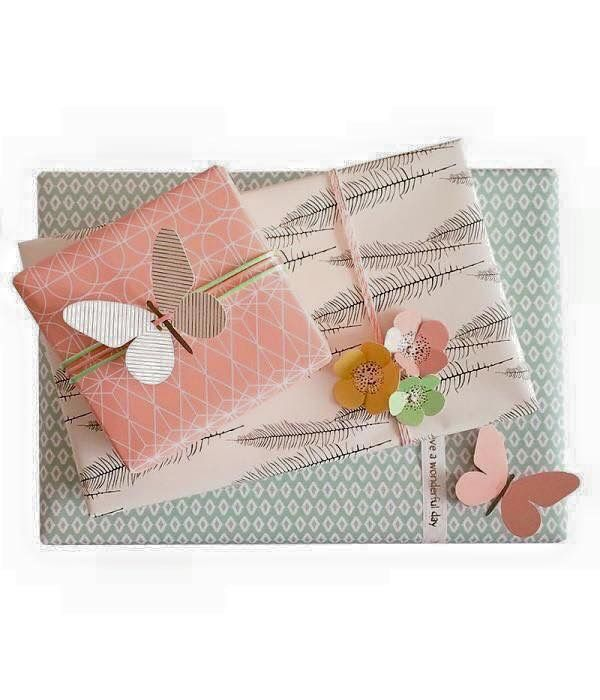Pastel papers, butterflies and flowers -- now we're talkin' gift wrapping! It's a scheme especially appropriate for spring!