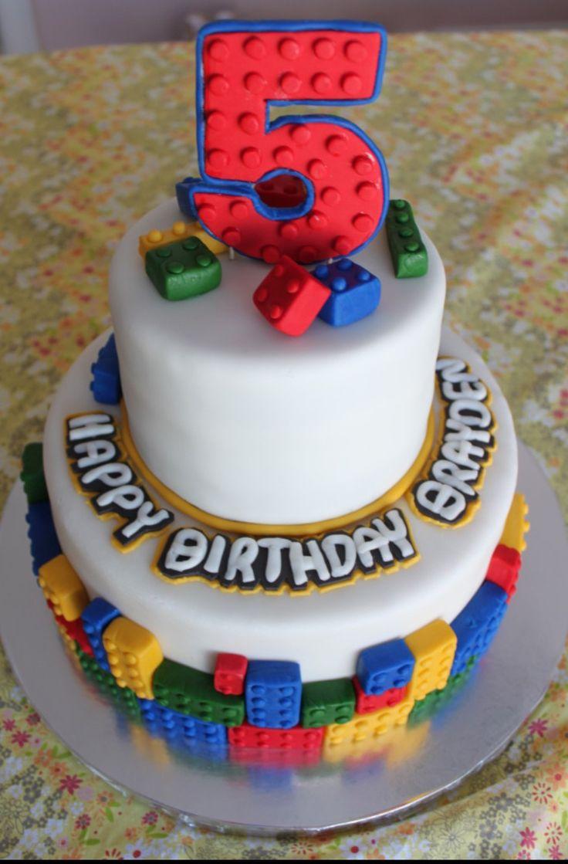 "LEGO Birthday Cake Idea-like bricks around base and ""scattered"" on top."