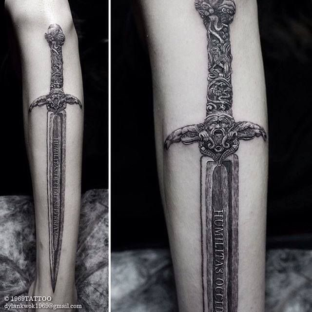 I just got this idea and looked it up and i absolutely love it. Having a sword tattoo going down the arm. Like a big one.