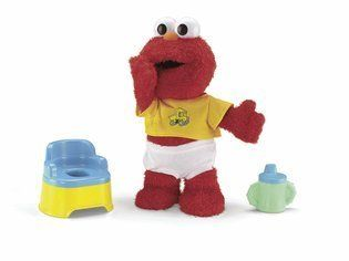 """Fisher-Price Potty time Elmo. Potty Time Elmo is an 11"""" tall feature plush. Children will love playing with and caring for baby Elmo. Help him learn to use the potty, too!. Comes with a sippy cup, removable training pants and a potty. Make potty training fun and help Elmo use the potty."""