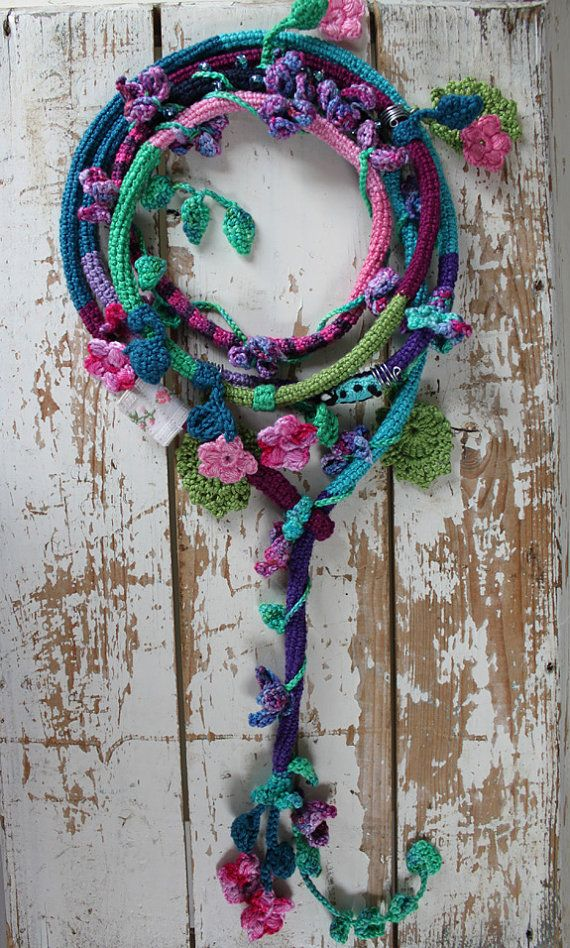 Romantic crochet necklace with climbing flowers and leaves, a ladybug, glassbeads and antique lace
