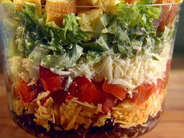Food Network invites you to try this Shredded Tex-Mex Salad with Creamy Lime Dressing recipe from Sunny Anderson.