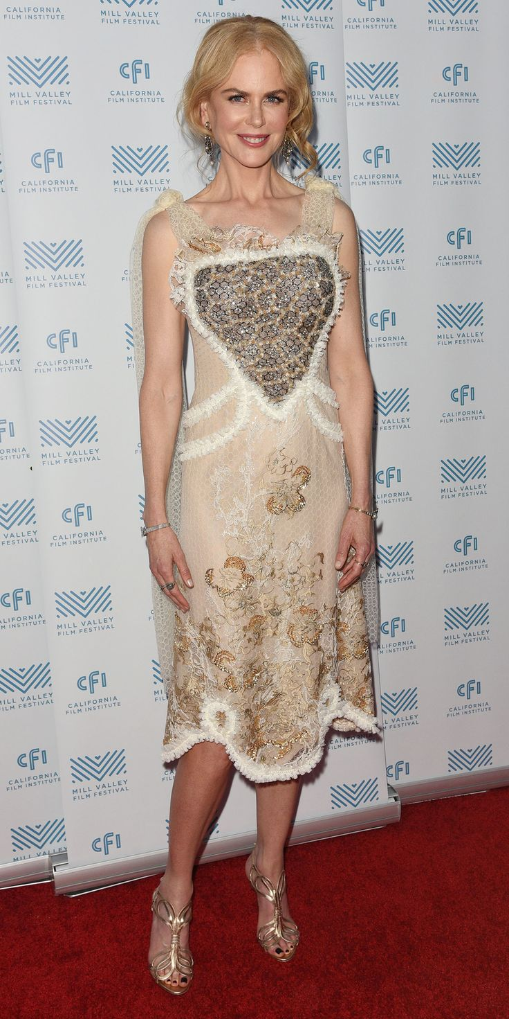 Nicole Kidman put her love on display at the Mill Valley Film Festival in a sheer honeycomb Rodarte number featuring gold floral embroidery and a ruffled, sparkly heart at the bodice. The finishing touches? A Nathalie Trad box clutch, Fred Leighton diamonds, and gold strappy sandals.