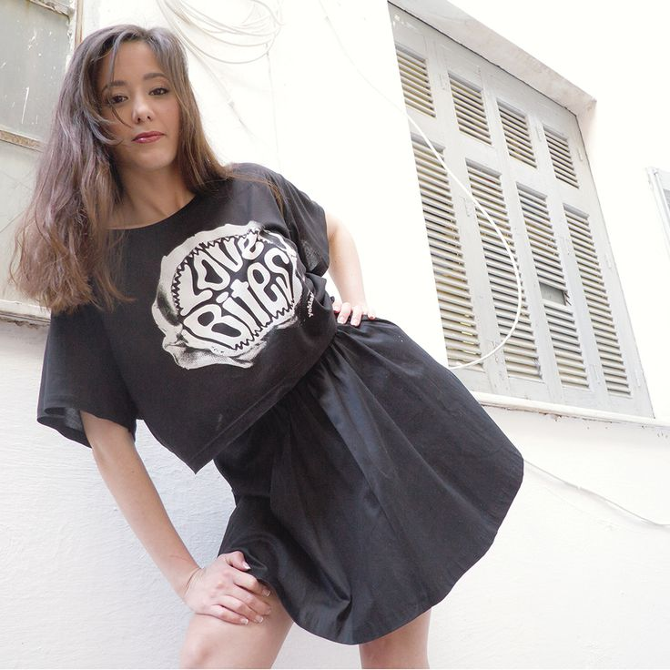 LOVE BITES // Single color screen-printed design on women's black oversized cropped top T-shirt made of 100% Tencel Lyocell Fine Jersey using water based ink.