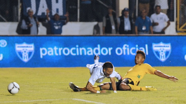 Jamaican Jermane Johnson (R) vies for the ball with Honduras' Arnold Peralta during their FIFA World Cup Brazil 2014 Concacaf qualifier football match at the National stadium in Tegucigalpa on June 11, 2013. AFP PHOTO /Orlando SIERRA #brazil2014 #sport #worldcup #betting #tips #updates #SMS #cup  JOIN THE WORLD CUP WITH http://prowintips.com
