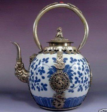 Rare Asian porcelain silver mounted teapot with Tibetan monkey with dragon on it
