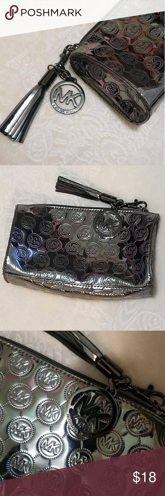MK Hand-Purse/Hand Wallet In awesome  condition  Nice silver/metallic color.  Small yet spactions in the inside  Can be used as a make-up bag if wanted to😊  *Please note* : I can not verfy authenticity, for it was a gift, but it could be authentic or not*  For I'm selling at a lower cost😊 Michael Kors Bags