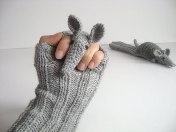 muratyusuf on Etsy makes custom fingerless gloves with armadillo puppet perched on top of hand!