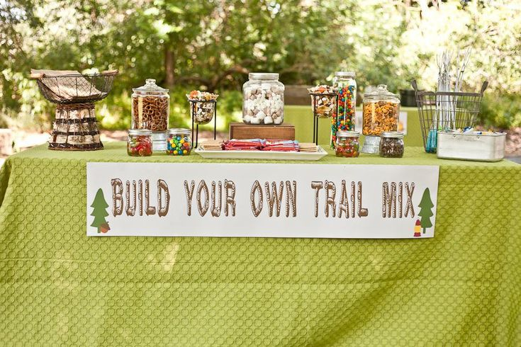 Take the fun outdoors and go camping for your first birthday. Get inspired by this camping-themed bash