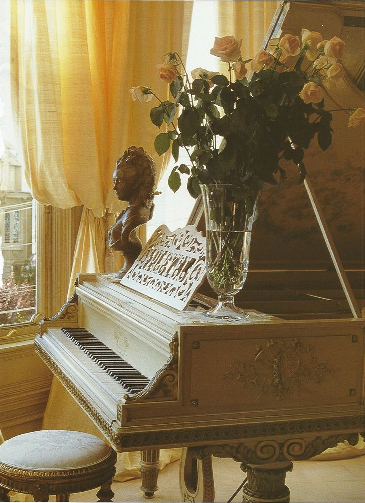 Another view of Jessica McClintock's garden room, where she comes to think, relax & rejuvenate. The Pleyel piano, purchased from an antiques dealer in France, is the same make that Mozart practiced on.  Photo (C) Jennifer Levy