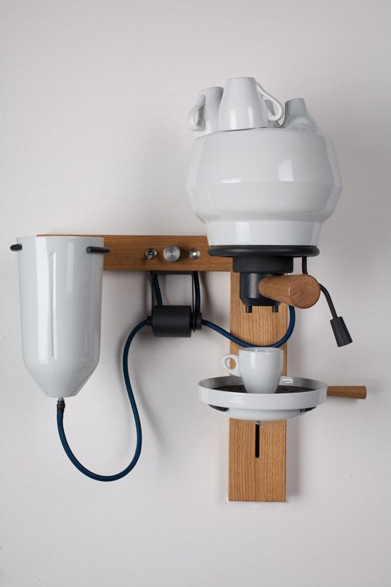 a beautiful coffeemaker that scraps all the metal, replacing it with porcelain and wood.