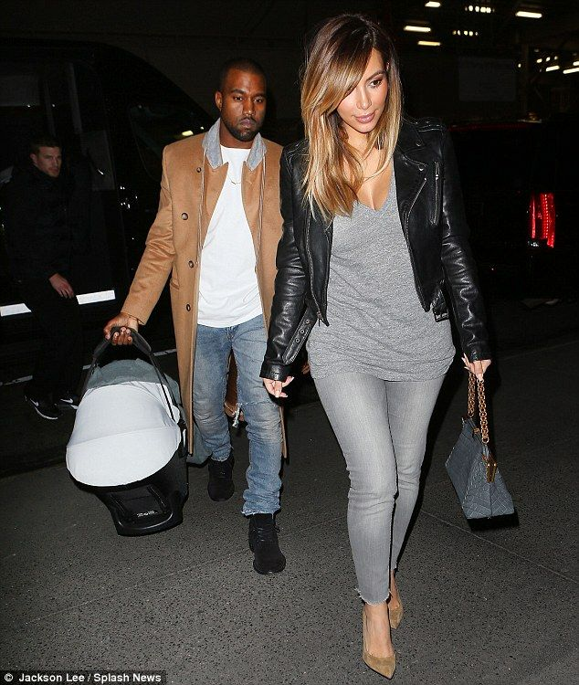 Casual night out: The famous couple both dressed down in jeans but Kim was sure to wear her heels