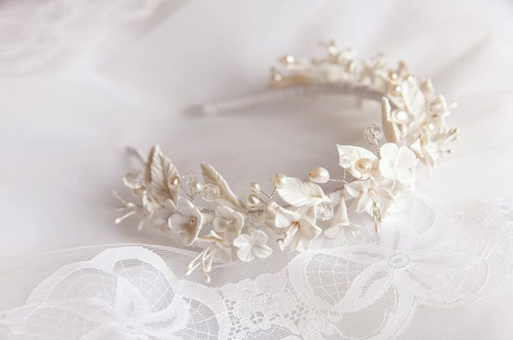 Handmade #bridal floral crown with freshwater pearls and flowers from polymer clay. Available in my Etsy shop http://ift.tt/1Ncye8a