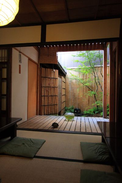 Tatami room, deck, and garden space in a traditional Japanese house.