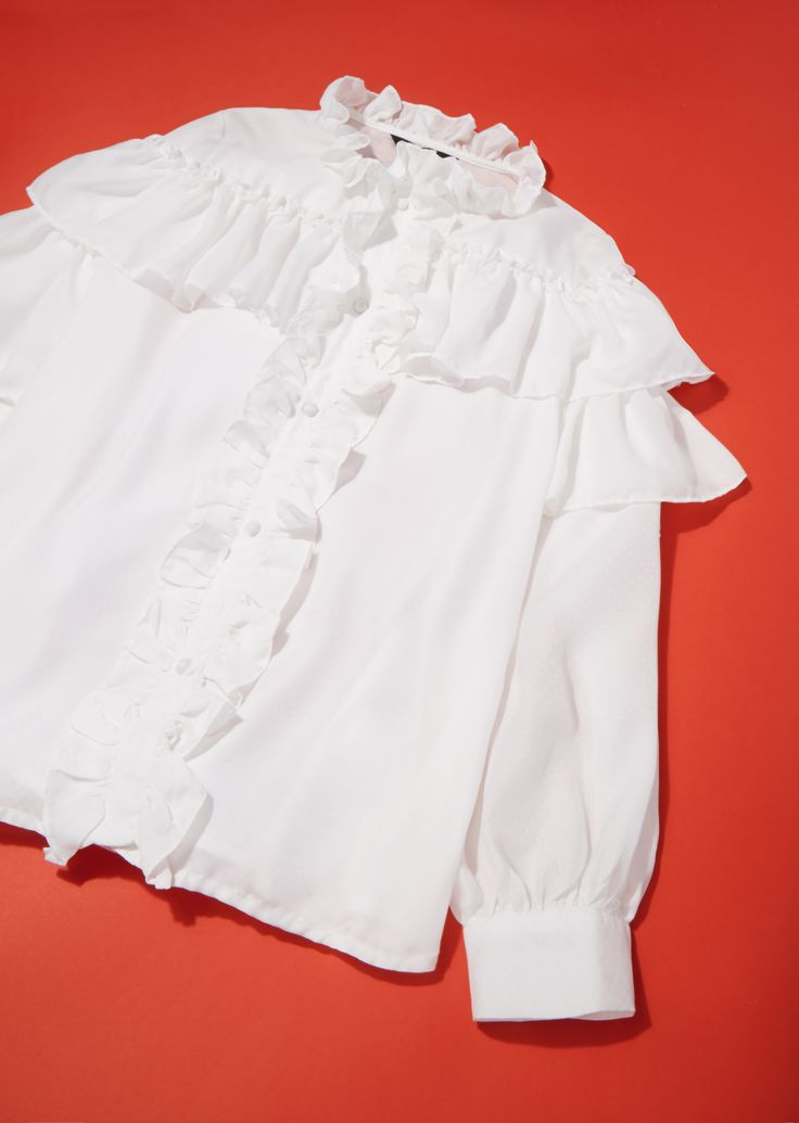 Incorporate regal drama into your wardrobe with Sister Jane's Victoriana ruffle-front blouse. Balance the delicate and feminine vibe by it teaming with stonewash denim and a slim-line clutch.