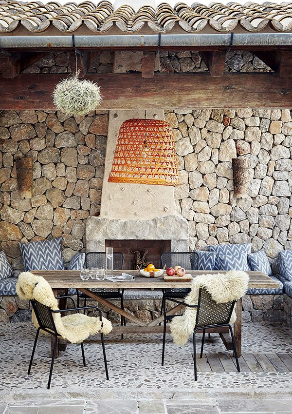 rock wall and outdoor fireplace