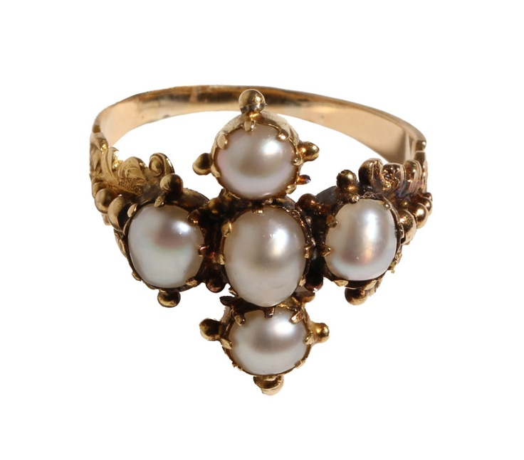 Beautiful ring made out of yellow gold and pearls. I may have just found my true love.
