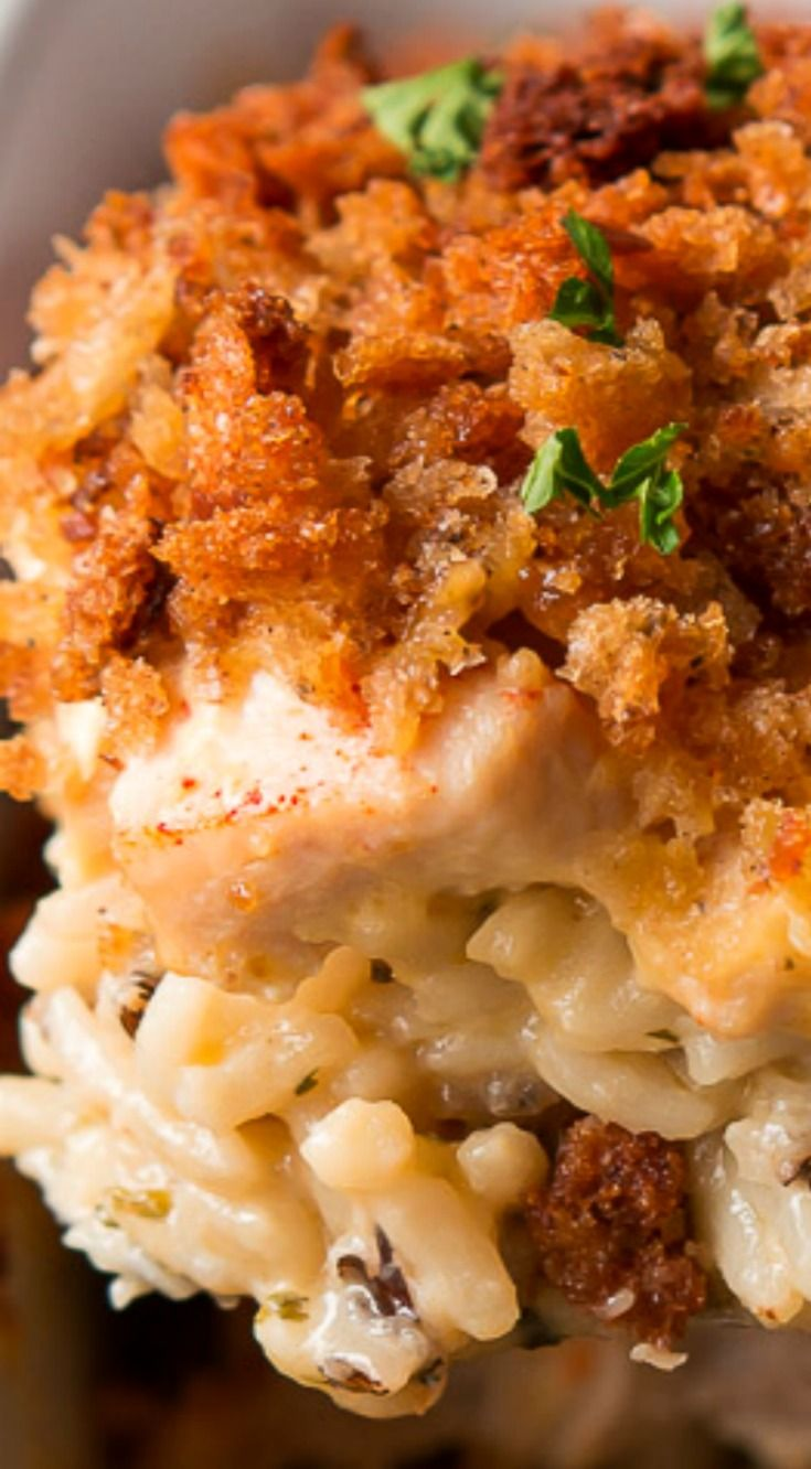 Chicken & Wild Rice Casserole ~ The ultimate comfort food layered with flavorful rice, chicken, a cheesy sauce, and crispy stuffing.